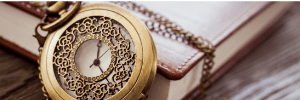 Ornate-fob-watch-resting-against-the-edge-of-a-journal-in-the-post-finding-time-to-read-your-Bible