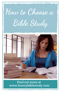 young-woman-sitting-at-a-desk-full-of-books-studying-her-bible-read-more-about-this-at-the-website-www-honey-bible-study-com